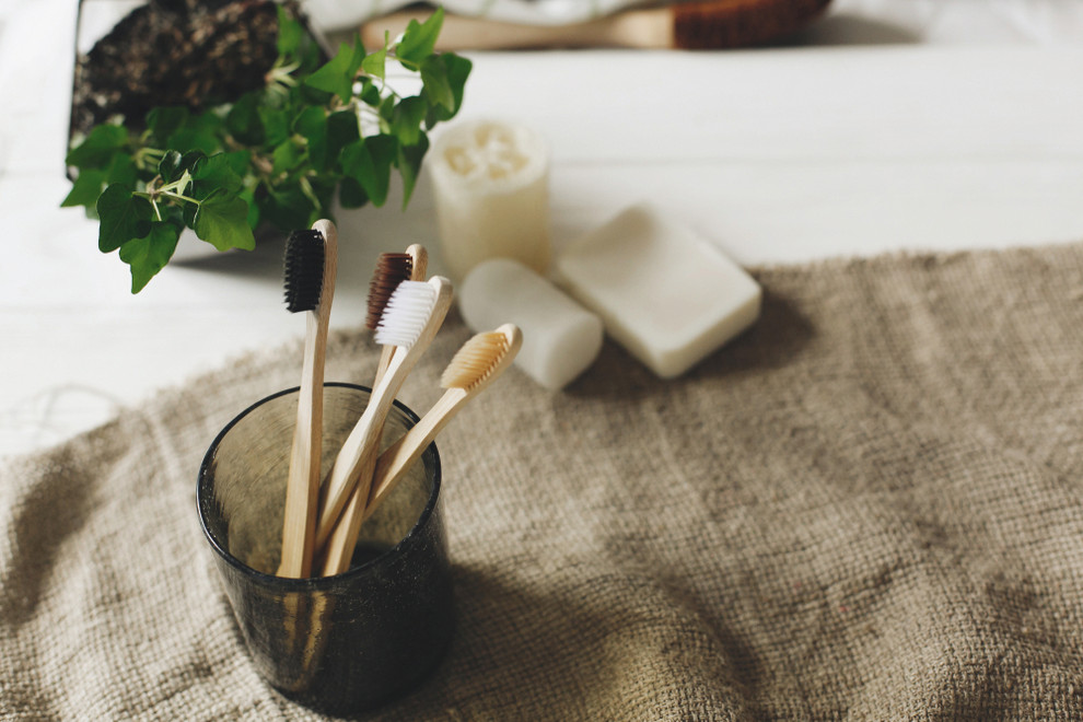 Bamboo toothbrushes in glass