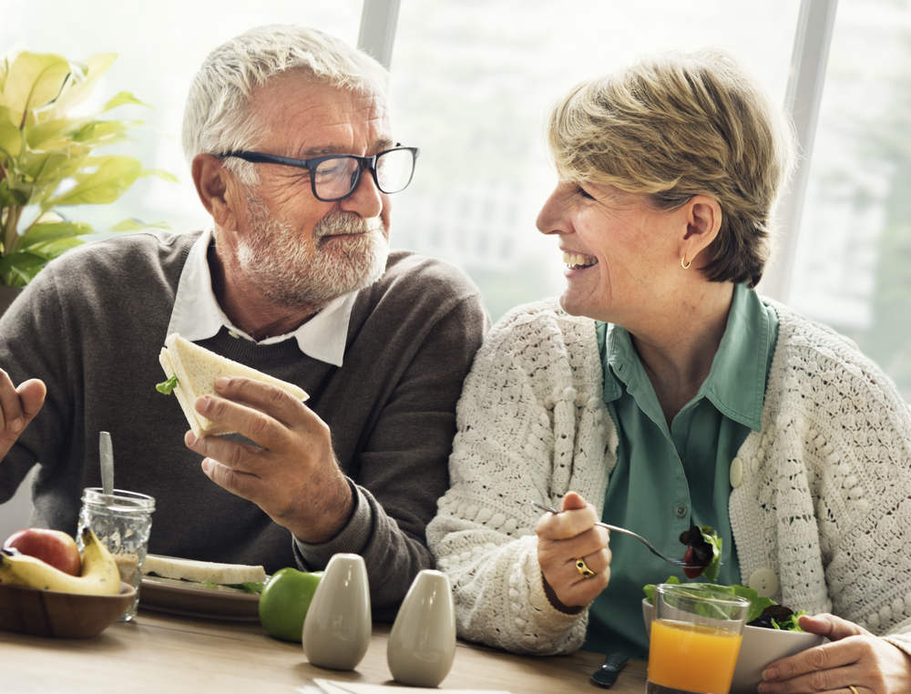 Senior Couple with permanent denture eating food