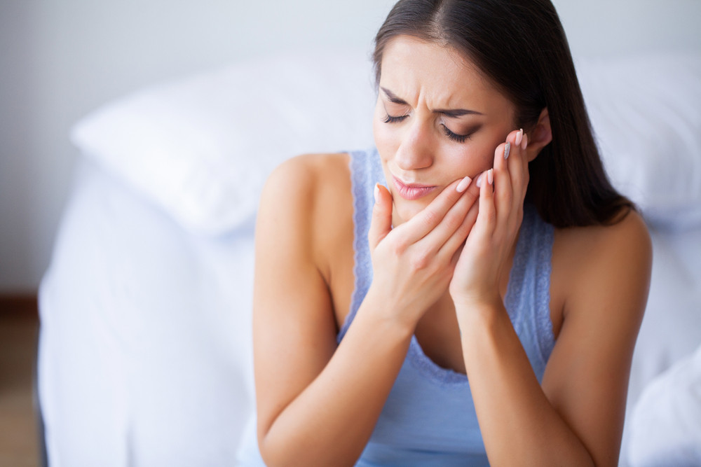 Woman in pain with root canal
